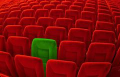 One green chair among Stock Photos