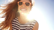 Summer girl laughing at camera on the beach in slow motion Stock Footage