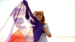 Smiling Woman with Texas state flag waving in the wind - stock footage