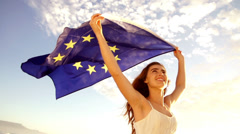 European Woman holding EU flag against sky waving Stock Footage