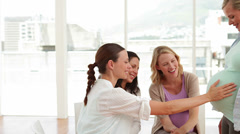 Pregnant women talking together at antenatal class Stock Footage