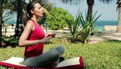 Beautiful woman doing breathing exercise in the garden HD Stock Footage