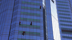 Cleaners for skyscraper Stock Footage