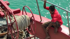 Thailand Ko Samui Island 006 Thai crew member in Bug crowsnest of tender boat Stock Footage