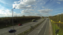 Time lapse of traffic on the A14 dual carriageway road in Northamptonshire Stock Footage