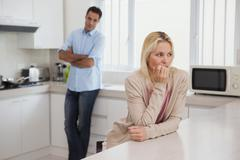 Stock Photo of Couple not talking after an argument in kitchen