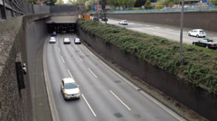 Traffic driving out of a tunnel on a german expressway - stock footage