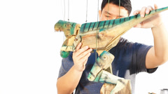 Puppeteer checking the operation of marionette Stock Footage