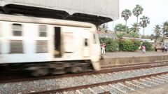 Passenger train arriving at station Stock Footage