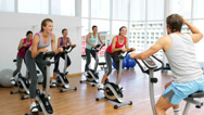 Stock Video Footage of Spinning class in fitness studio led by energetic instructor