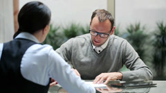 Businesspeople signing documents in the office on glass table. Stock Footage