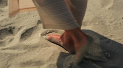 Footprints on the beach left behind Stock Footage
