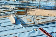 Stock Photo of Construction Site Composition with Blue Sheet
