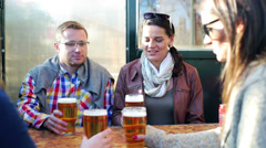 Friends toast beer talking and smiling, steadycam shot. Stock Footage