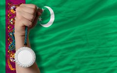 silver medal for sport and  national flag of turkmenistan - stock photo