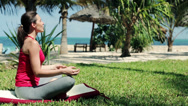 Stock Video Footage of Young beautiful woman meditating in the garden HD