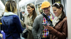 People talking and using cellphone on subway, steadycam shot. - stock footage