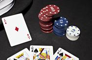 Stock Photo of Poker ace bet good hand
