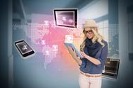 Stock Illustration of Stylish blonde using tablet pc with connecting devices
