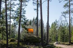 Hunting tower in rocky forest Stock Photos