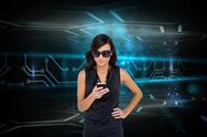 Stock Illustration of Glamorous brunette using smartphone against circuit board