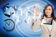 Stock Illustration of Smiling businesswoman pointing to apps flying between devices