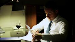 Businessman signing documents at night by the table. Stock Footage