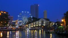 Time Lapse Melaka Malacca river cruise tour boat at dusk Malaysia Asia Stock Footage