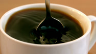 Stock Video Footage of Teaspoon stirring coffee in a cup