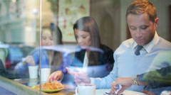 Businesspeople drink coffee in cafe and talking during break, steadycam shot. Stock Footage
