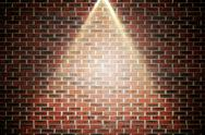 Stock Illustration of Red brick wall under spotlight