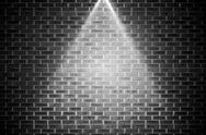 Stock Illustration of Grey brick wall under spotlight