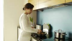 Woman cooking vegetables at home Stock Footage