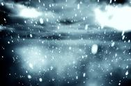 Stock Illustration of Cloudy sky with snow falling