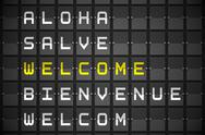 Stock Illustration of Welcome in languages on black mechanical board