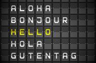 Stock Illustration of Hello in languages on black mechanical board