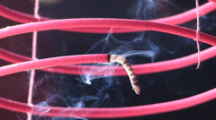 S/M Kuala Lumpur Chinatown Quan Di Temple spiral incense hanging Malaysia Asia Stock Footage