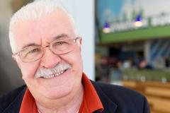 Friendly sincere senior man in glasses Stock Photos