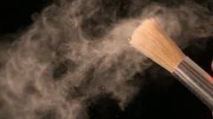 Woman shaking make up brush Stock Footage