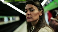 Women waiting for subway on the station, steadycam shot. Stock Footage