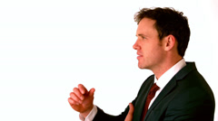 Happy businessman laughing with hand on chin Stock Footage