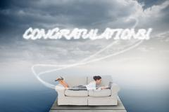 Stock Illustration of Congratulations! against cloudy sky over ocean