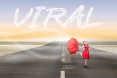 Stock Illustration of Viral against road leading out to the horizon