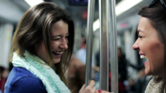 Happy women talking and smiling in subway, steadycam, shot. Stock Footage