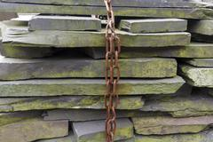 Slate slab stacked with chain Stock Photos