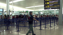 Passengers in the airport thru check in lines Stock Footage