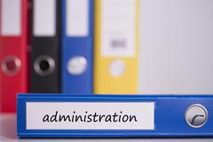 Stock Photo of Administration on blue business binder
