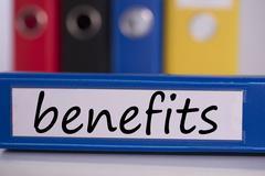 Benefits on blue business binder Stock Photos