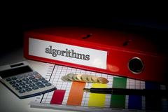 Stock Photo of Algorithms on red business binder