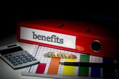 Benefits on red business binder Stock Photos